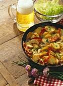 Potato & mushroom pan with bacon strips & onions