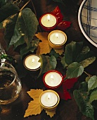 Table decoration: tea lights in vine leaf candlesticks