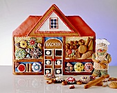 Decorated Gingerbread House with Assorted Gingerbread Cookies