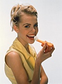 Woman Eating Carrot with Dip