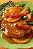 Pork steak with orange & mustard sauce & orange slices