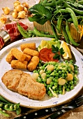 Veal steak with peas and onions and croquettes