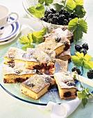 Semolina slices with blackberries on cake plate