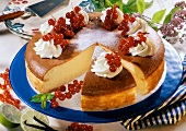 Cheesecake with cream and fresh redcurrants