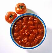 Bowl of fresh tomato sauce with chopped tomato pieces