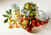 Three preserving jars with pickled vegetables
