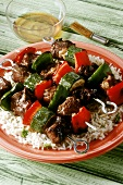 Lamb and vegetable kebabs on a bed of rice