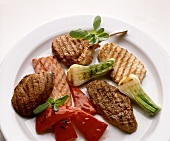 Plate of various grilled meats and vegetables