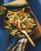 Ham and noodle stir-fry with courgette strips