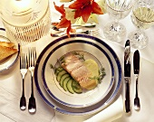 Poached salmon fillet on sliced cucumber