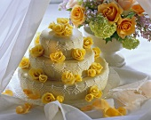 Tiered wedding cake decorated with marzipan roses