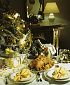 Festive Christmas table with goose and champagne