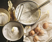 Ingredients still life: eggs, sugar, egg white, alcohol & cream