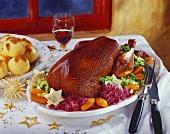 Crispy Christmas goose on vegetable platter