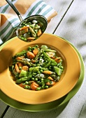Asparagus casserole with spring vegetables and mint