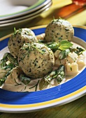 Basil dumplings on asparagus ragout