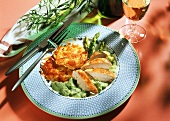 Chicken breast fillets in asparagus sauce with rosti