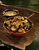 Caracoles con sobrassada: snails with pepper sausage