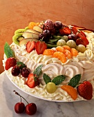 Meringue gateau with cream and fresh fruit