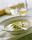 Chick pea soup with baguette as accompaniment