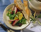 Mangetout salad with orange slices and olives