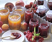 Fruit jam with berries, peaches and apricots