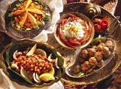 Indian table with kebabs, raita, chick peas & lentils