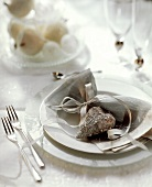 Festive table setting with a silver heart