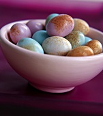 Colourful eggs in a white bowl