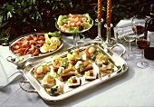 Appetiser buffet with canapes, roast beef and shrimps
