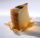 A piece of Manchego on paper (Spanish hard cheese)