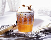 Pumpkin drink with milk froth and truffle