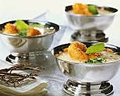 Whipped coconut soup with lobster meat