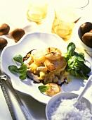 Pilgrim scallops with potatoes on chestnut sauce