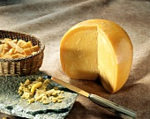 Mimolette (French hard cheese) piece, thinly sliced & cubed