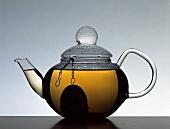 A pot of tea with tea infuser
