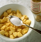 Sugaring finely chopped peaches