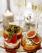 Canapes with pilgrim scallops, cheese, figs & herbs