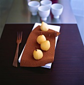 Poached pears on chocolate leaf