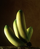 Bunch of bananas against brown background