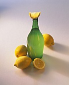 A bottle of lemon vinegar and lemons