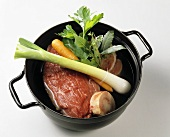 Ingredients for beef soup in a pot