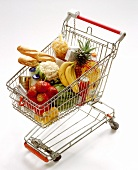 Shopping trolley with various foodstuffs