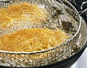 Frying turkey with potato coating in a deep fat fryer