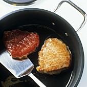 Frying beef sirloin in oil