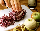 Cutting red cabbage into strips