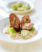 Ostrich roulade with Brussels sprouts and apple