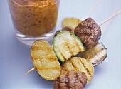 Ostrich meat kebabs with almond and paprika dip