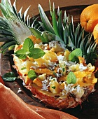 Chicken breast & pineapple salad with coconut flakes