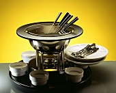 Fondue pot and fondue utensils